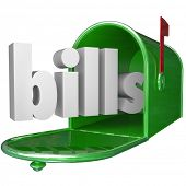 The word Bills in a green metal mailbox to illustrate your debt such as credit card and utilities pa