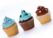pic of cupcakes  - Three cupcakes in a row isolated against white - JPG