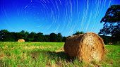 image of moonlit  - Moonlit hay bale under star trails on a farm in North Georgia - JPG