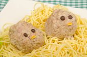 stock photo of meatball  - Pasta with meatball faces funny food for kids - JPG