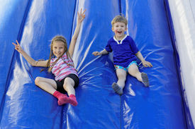 stock photo of inflatable slide  - Funny kids and off the inflatable slides - JPG