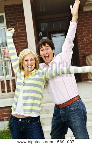 Excited Couple At Home