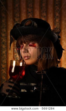 Fashionable Girl With Glass Of Wine