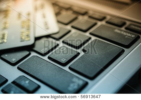 credit card and laptop keyboard