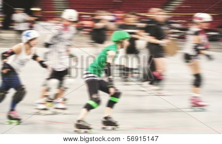 some women participating in roller derby with a motion blur