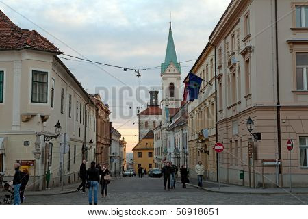ZAGREB, CROATIA - JANUARY 12, 2014: Cirilometodska street that leads to famous St Mark's Church and Lotrscak Tower at sunset.