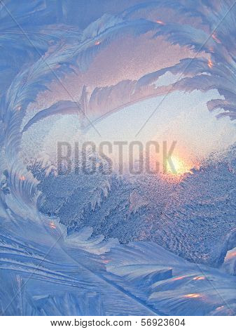 Ice Pattern And Sunlight On Winter Glass