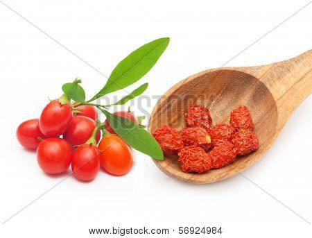 Goji berry dried and fresh isolated on white background.