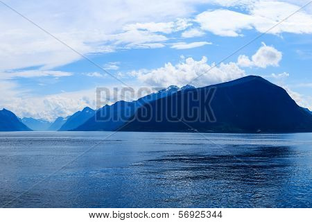 Mountains and fjord in the late afternoon
