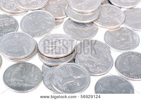 Bunch of dollar quarters over white