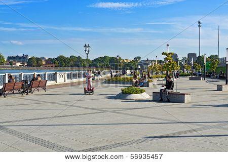 KALININGRAD, RUSSIA - September 2, 2012: Townspeople Walk Along the Waterfront of Lake Verhnee
