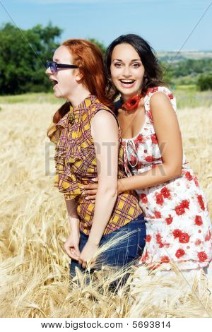 Two Girls Laughing On Wheat Field