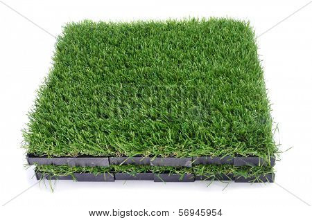 some tiles of artificial turf on a white background