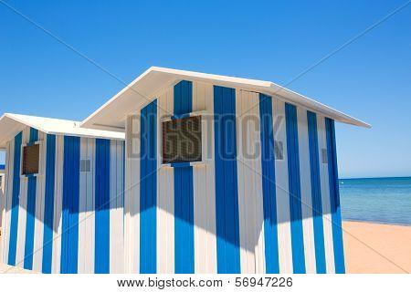 Beach houses in Alicante Denia blue and white stripes at Mediterranean sea of Spain