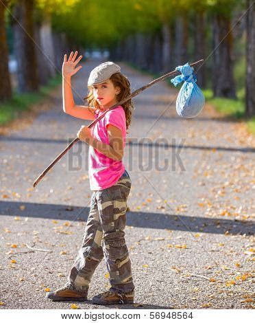 little kid with hobo stick bag and bundle girl saying goodbye with hand