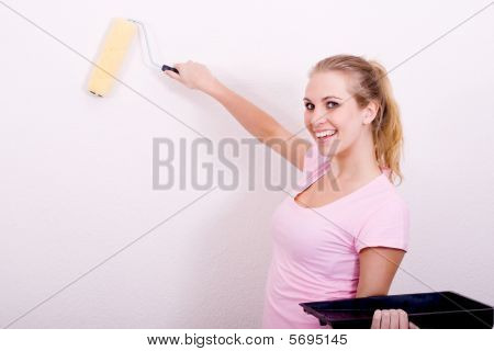 woman painting apartment