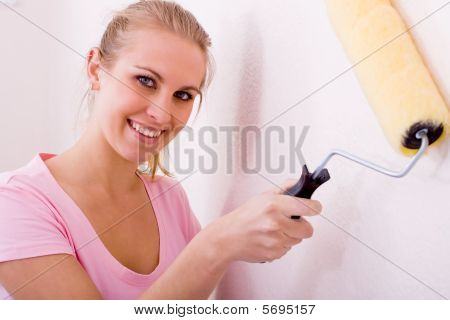 woman painting apartement
