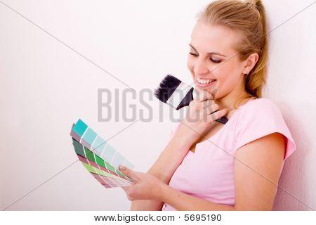 Woman choose paint color