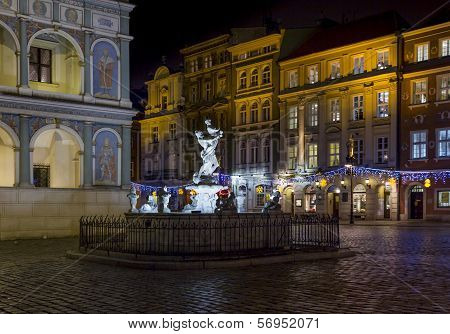 Fragment Of  Historical Town Square In Poznan, Poland With A Fountain And City Hall