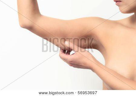 Woman Testing The Flabby Muscle Under Her Arm