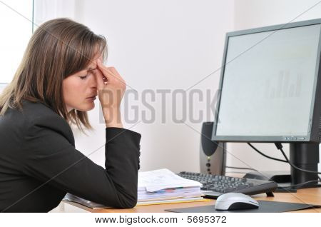 Tired Business Person With Headache In Work
