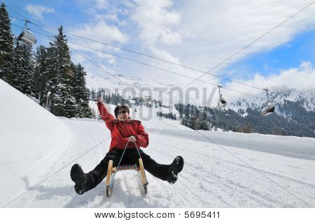 Senior Woman On Sledge Having Fun