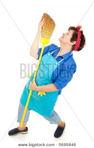 Maid Dancing With Broom