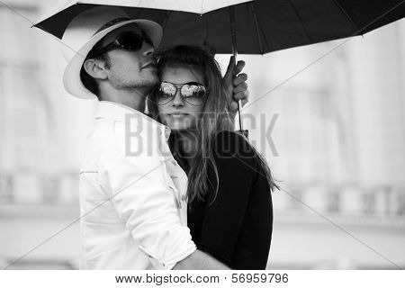 Young couple in love with umbrella