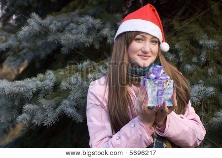 Girl With Present In Christmas Hat