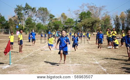 Unidentified Thai students 4 - 12 years old athletes in action during sport day