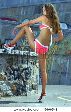 Girl In Bathing Suit Near A Embankment