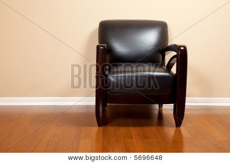 An Empty Black Leather Chair In House