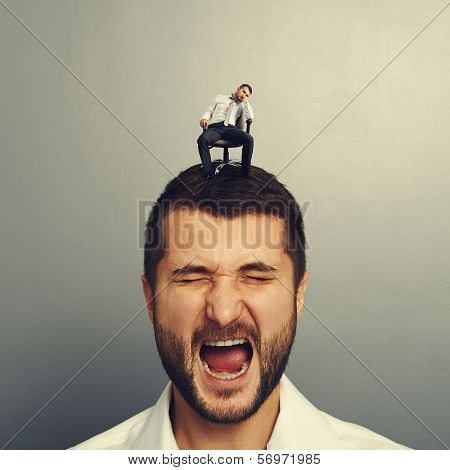emotional man with small bored man on the head