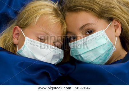 Two Girls Sick In Bed