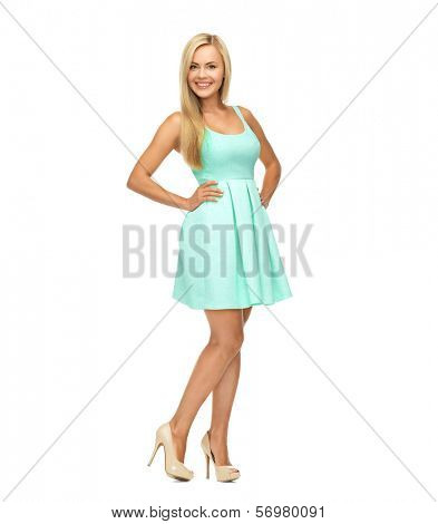 beauty, fashion and happy people concept - young woman in yellow dress and high heels