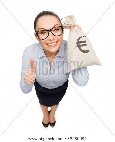 business, money and office concept - smiling businesswoman in eyeglasses holding money bag with euro and showing thumbs up