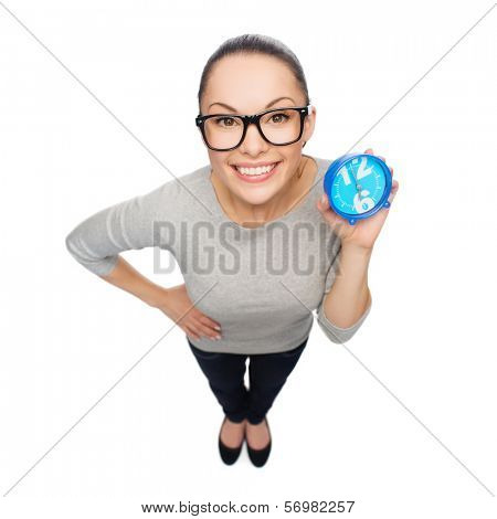 time and deadline concept - smiling woman in eyeglasses with blue clock