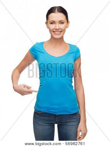 clothing design and gesture concept - smiling girl in blank blue t-shirt pointing her finger at herself