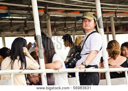 Unidentified People Traveling On Ferryboat.