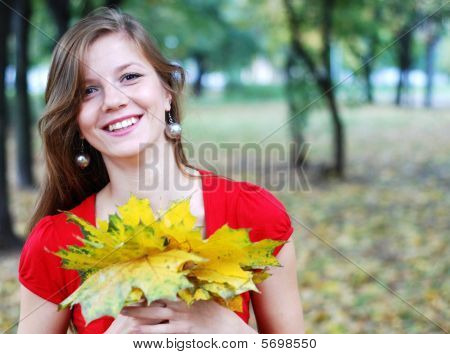Woman With Yellow  Leaves