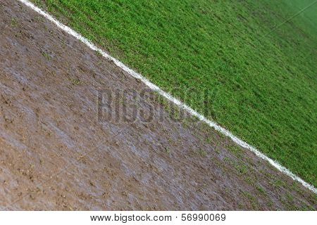 Border line of a football field photographed on a rainy day