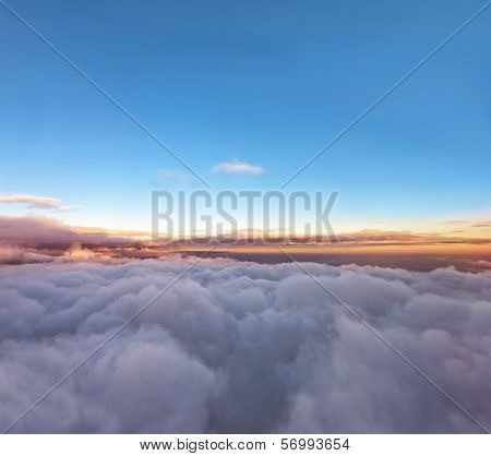 Velvet Sunset Above Cloudscape From Airplane