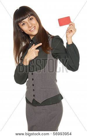 Smiling business woman holding credit card