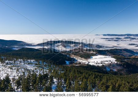 View of a low clouds on winter mountain ridge