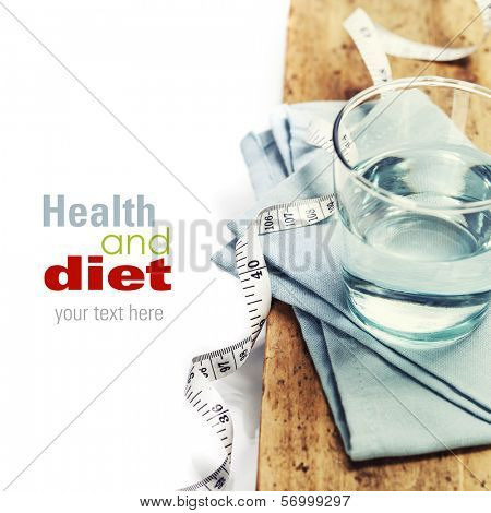 Glass of water and  measuring tape - healh and diet concept - over white (with easy removable sample text)