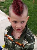 stock photo of adverb  - kid with great hair
