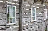 Weathered Stack Log Wall With Windows poster