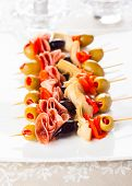 stock photo of artichoke hearts  - Antipasti skewers with olives - JPG