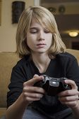 stock photo of controller  - Young teen concentrating on his game controller - JPG
