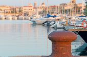 stock photo of bollard  - a rusty bollard in Alghero harbor in Sardinia - JPG